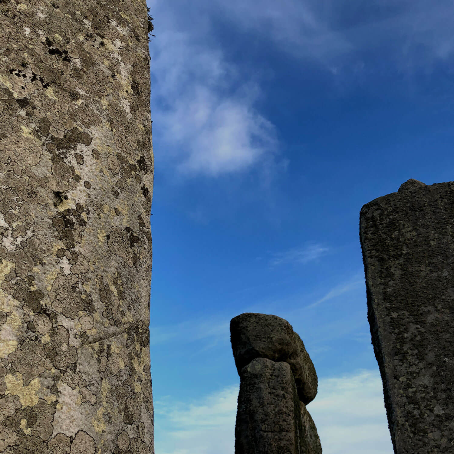 Blue skies above standing stones