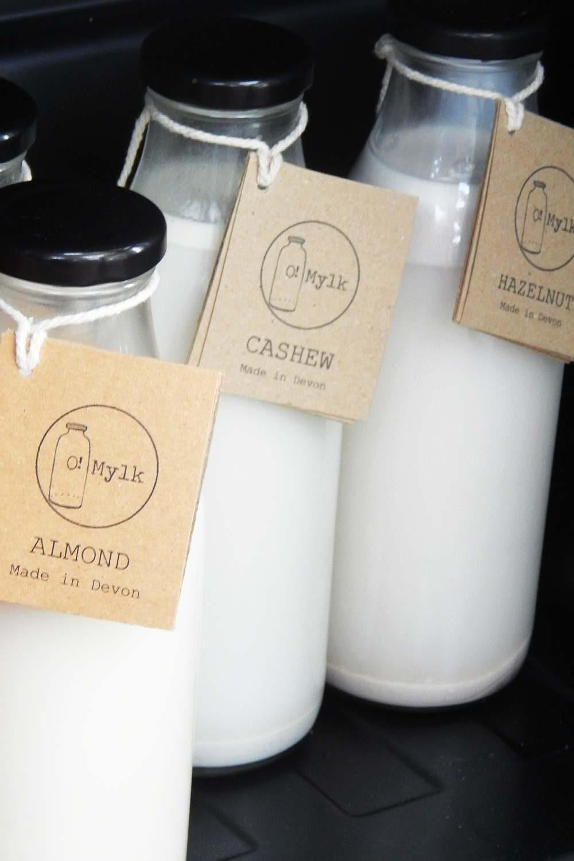 Nut milks in glass bottles - almond, cashew and hazelnut