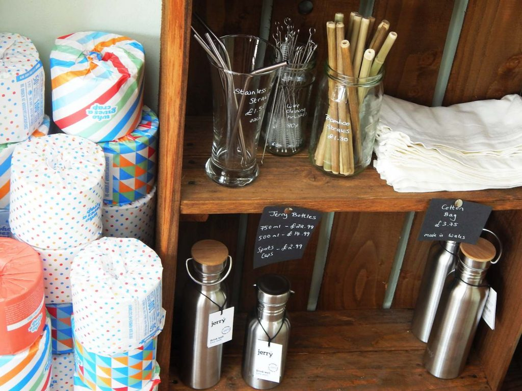 Loo roll wrapped in paper and reusable straws