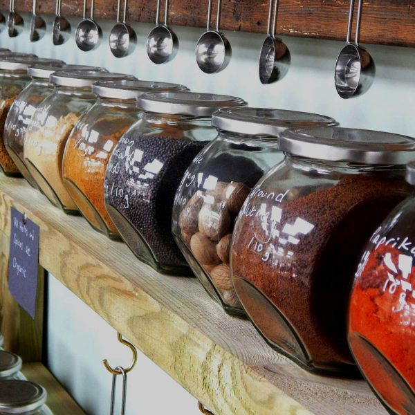 Jars of spices and steel scoops