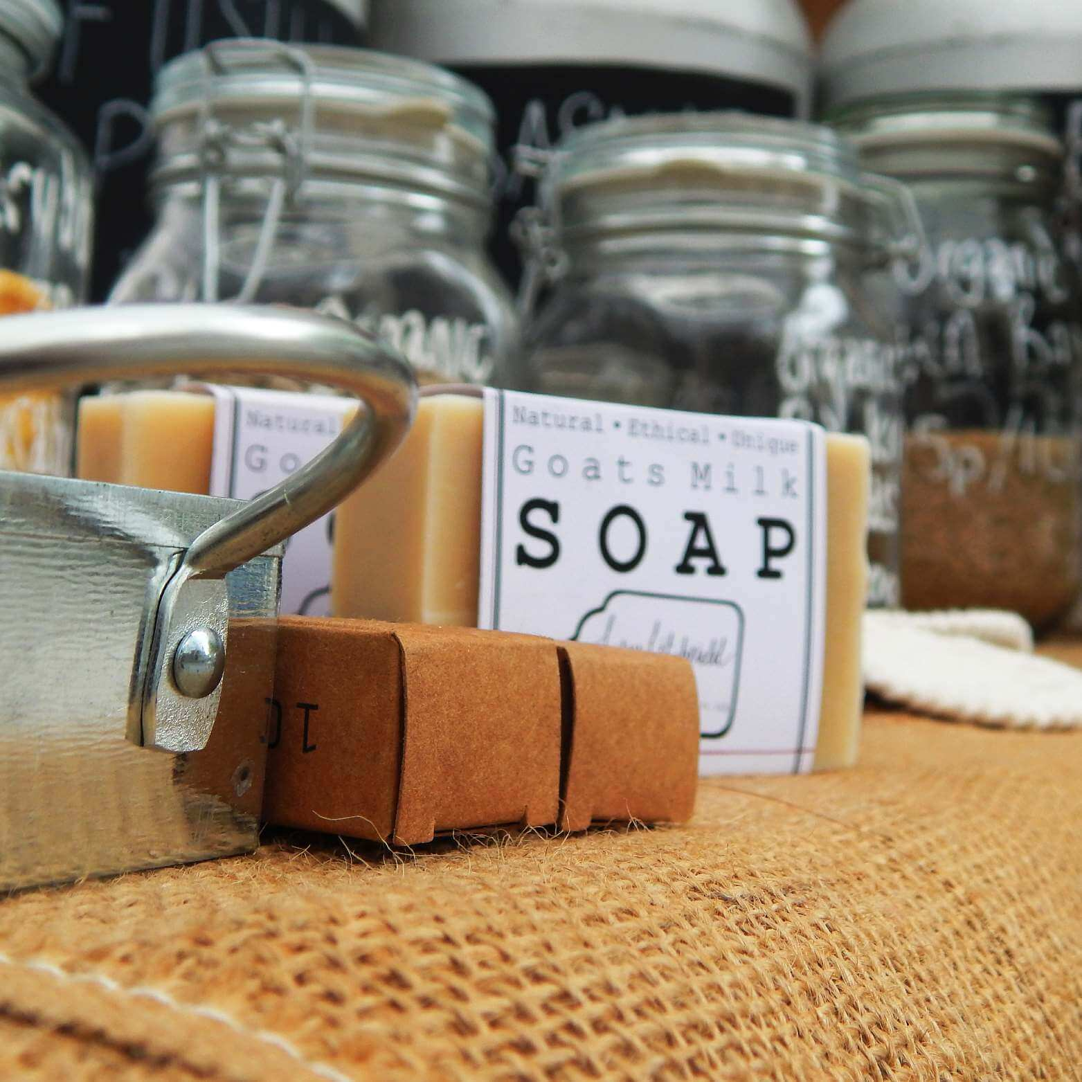 Close up of soap and other plastic free products on a market stall