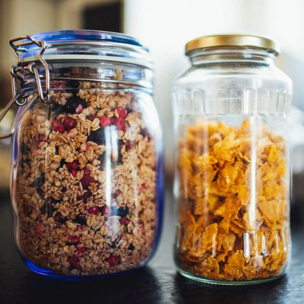 Glass jars of cereal and granola