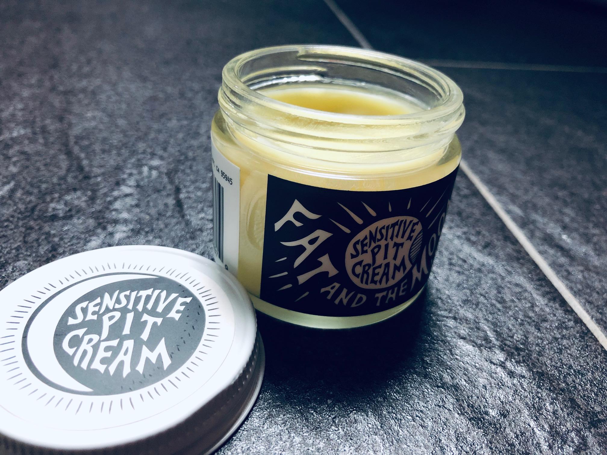Open jar of deodorant cream