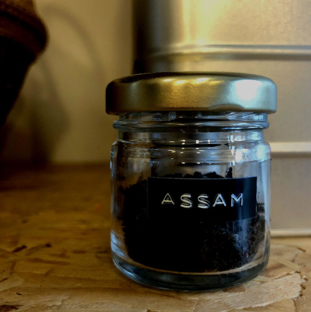 Small jar of loose leaf tea labelled Assam